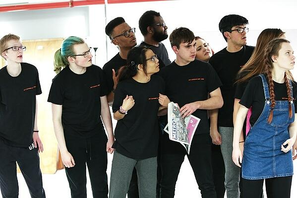 Group of drama students acts together