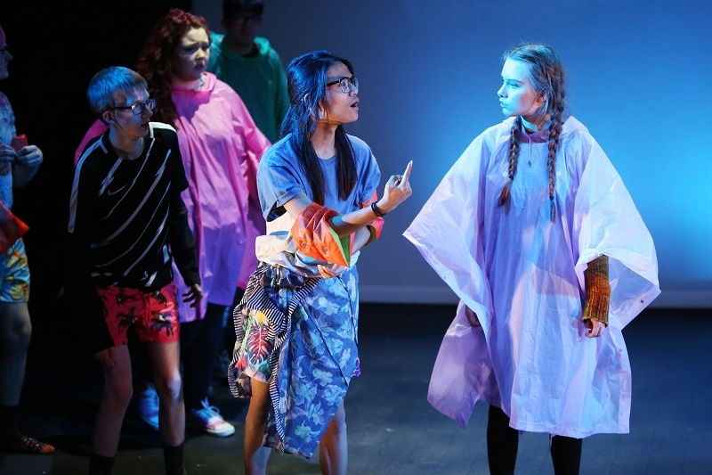 Group of drama students act on the stage